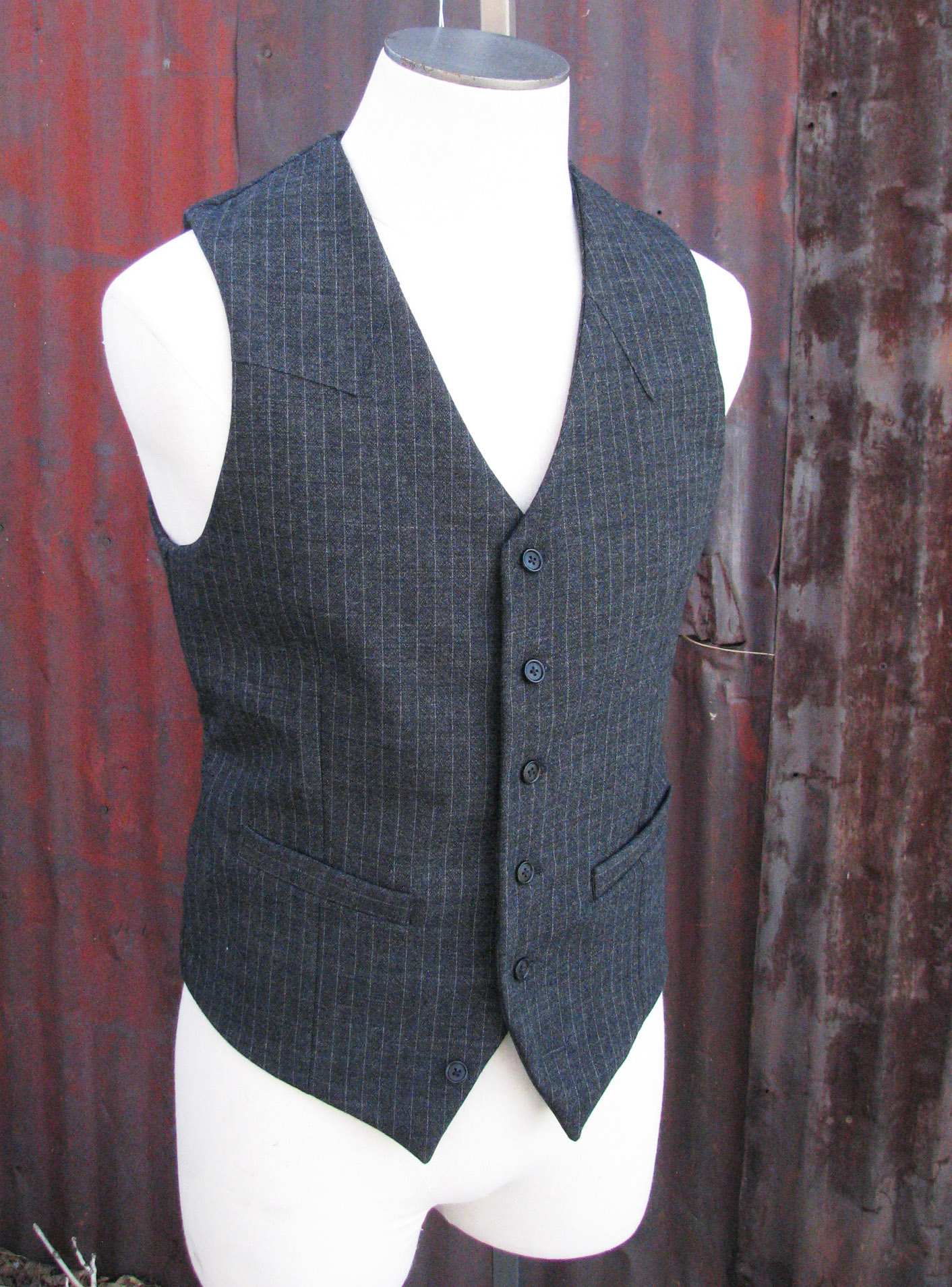 Vest definition is - a sleeveless garment for the upper body usually worn over a shirt. How to use vest in a sentence. a sleeveless garment for the upper body usually worn over a shirt.